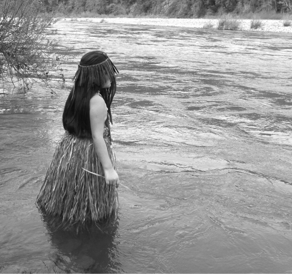 girl walking in river